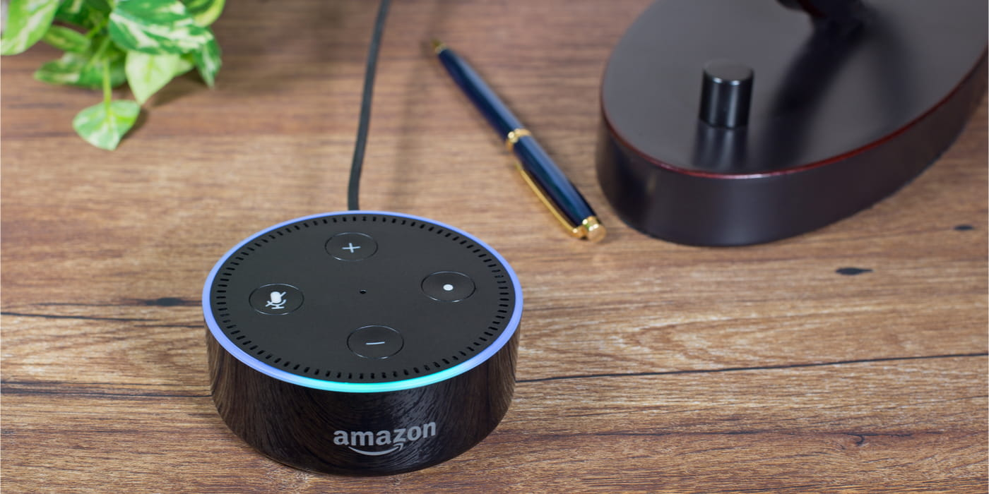 Amazon Echo dot sitting on wood table