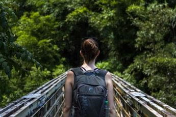 woman hiking with backpack