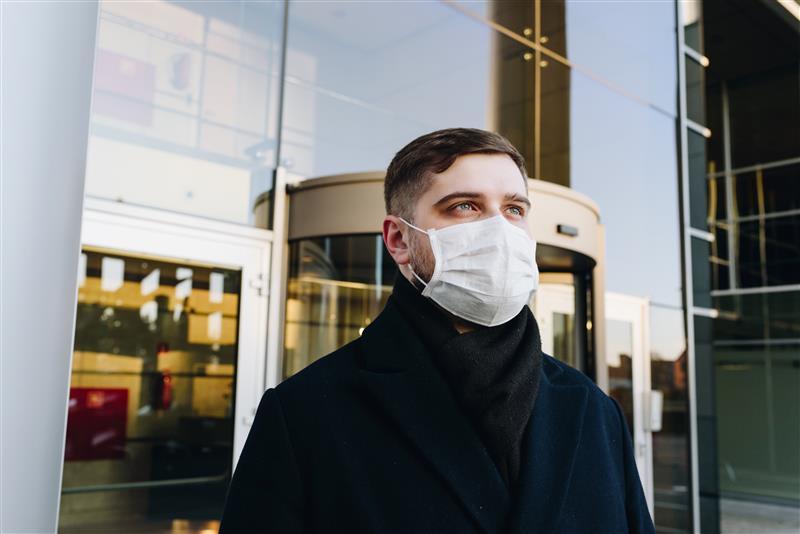 man wearing face mask banner