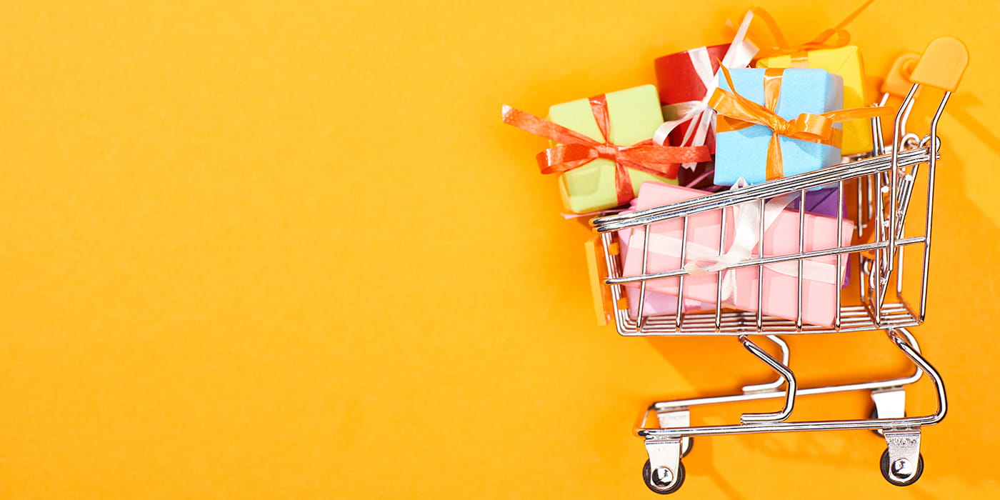 shopping cart with wrapped gifts