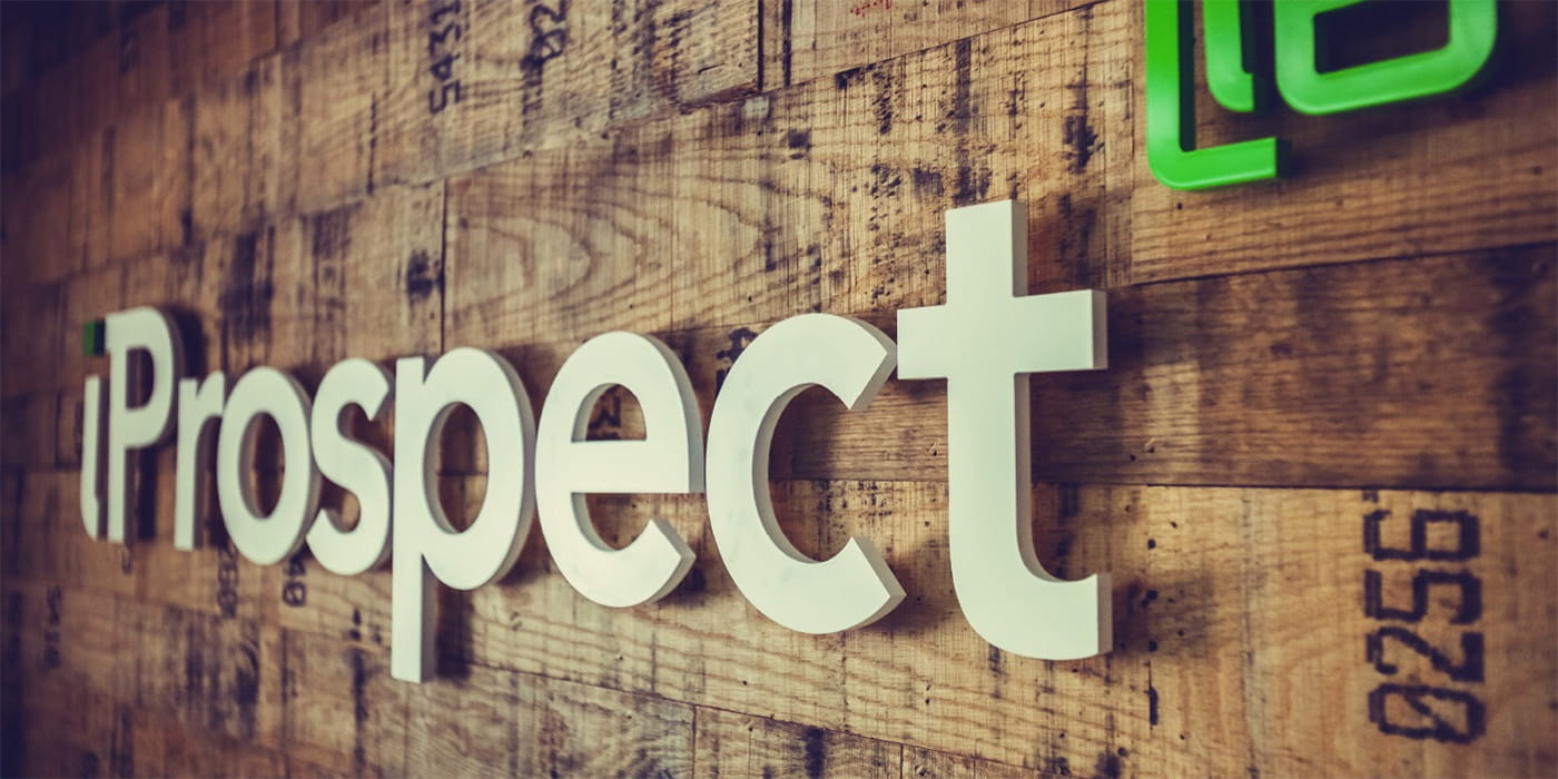 iProspect logo on a wood wall