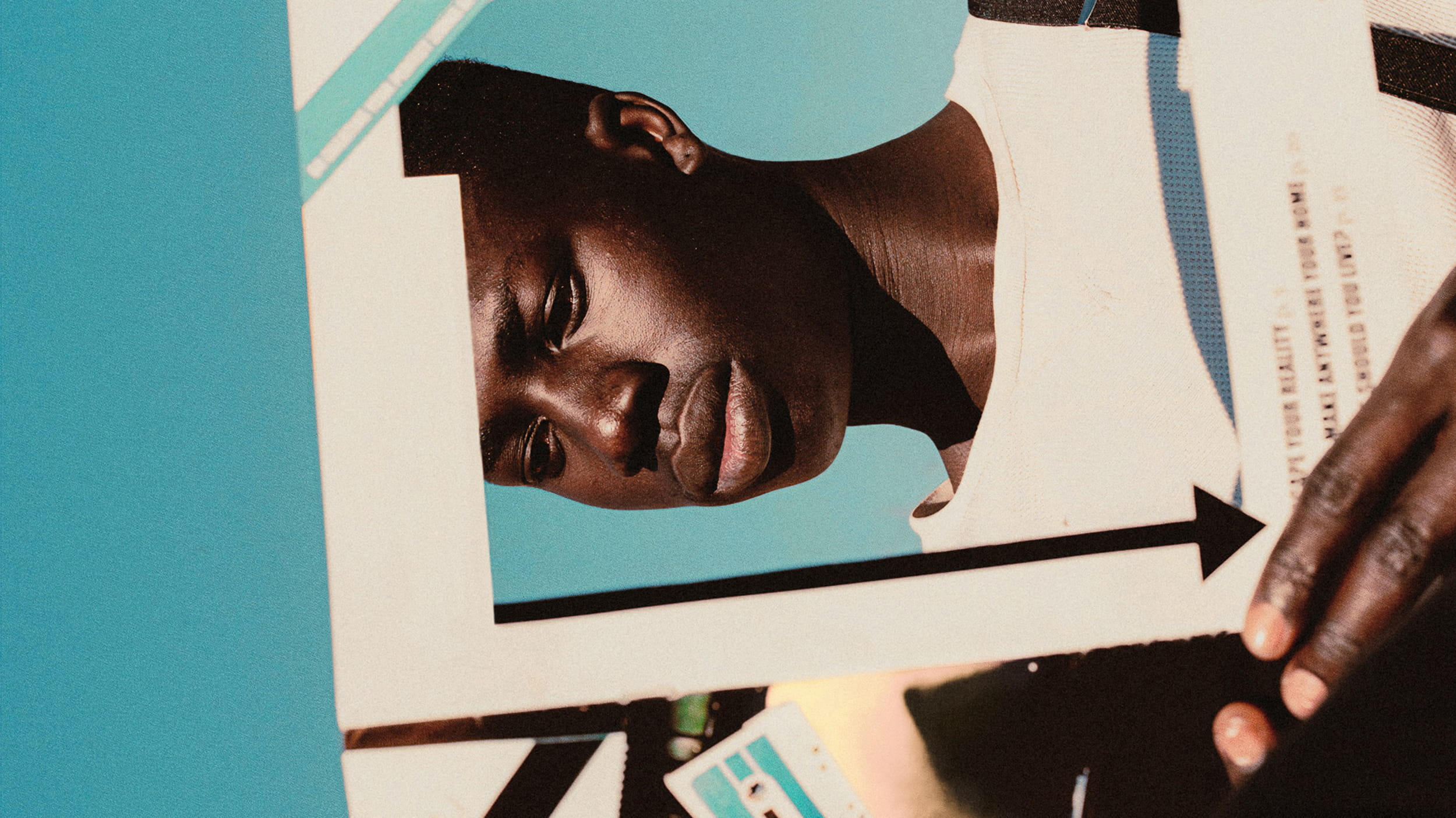 Horizontal image of a man reading a magazine with the front cover cut out so his face is visible| iProspect Global