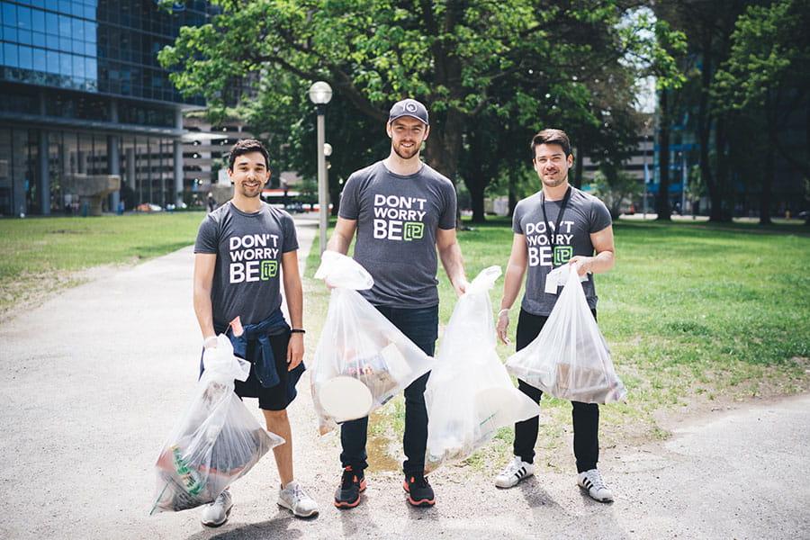 men picking up garbage