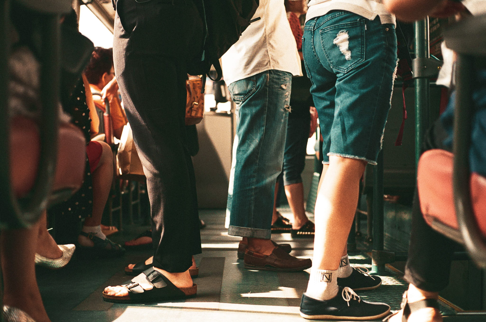 Image of people's legs standing in a crowded place
