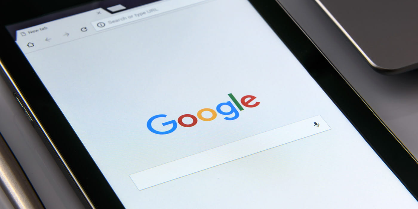 Google homepage shown on a tablet